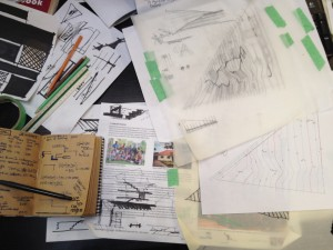 My desk currently hidden by a sea of sketching and notes on pathways.